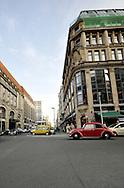 Red vintage volkswagen beetle stopped at crossing of Berlin street
