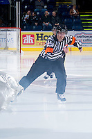 KELOWNA, CANADA - DECEMBER 5: Jeff Ingram, WHL referee, enters the skates on the ice at the start of the game between the Swift Current Broncos at the Kelowna Rockets on December 5, 2012 at Prospera Place in Kelowna, British Columbia, Canada (Photo by Marissa Baecker/Shoot the Breeze) *** Local Caption ***
