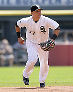 CHICAGO - AUGUST 31:  Carlos Sanchez #77 of the Chicago White Sox fields against the Detroit Tigers on August 31, 2014 at U.S. Cellular Field in Chicago, Illinois.  (Photo by Ron Vesely)
