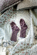 hand knitted socks on a vintage bed