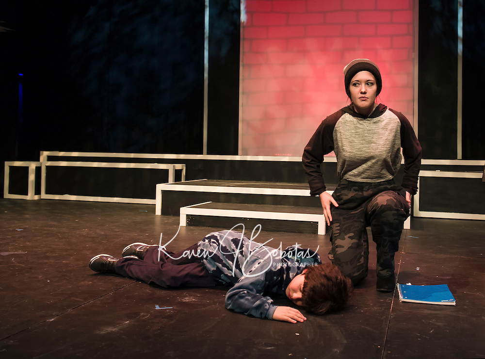 """Maggie A. Godsoe as Carter finds Santiago McCulloch as Eric in the street during dress rehearsal for """"Boy Who Drew Cats"""" at the Winnipesaukee Playhouse on Wednesday evening.  (Karen Bobotas/for the Laconia Daily Sun)"""