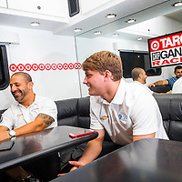 ST. PETERSBURG, FL - March 29, 2015 -- IndyCar drivers Tony Kanaan, left, and Sage Karam share a laugh during the St. Pete Grand Prix in downtown St. Petersburg, Florida. (PHOTO / CHIP LITHERLAND)