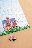 Jigsaw puzzle with house elevated view