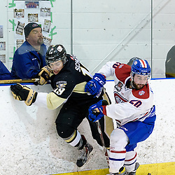 KINGSTON, - Apr 6, 2016 -  Ontario Junior Hockey League game action between Trenton Golden Hawks and Kingston Voyageurs. Game 4 of the North East Championship series.  at the Invista Centre, ON. Reed Kekewich #20 of the Kingston Voyageurs makes the hit on Ben Scheel #19 of the Trenton Golden Hawks during the first period. (Photo by Ian Dixon / OJHL Images)