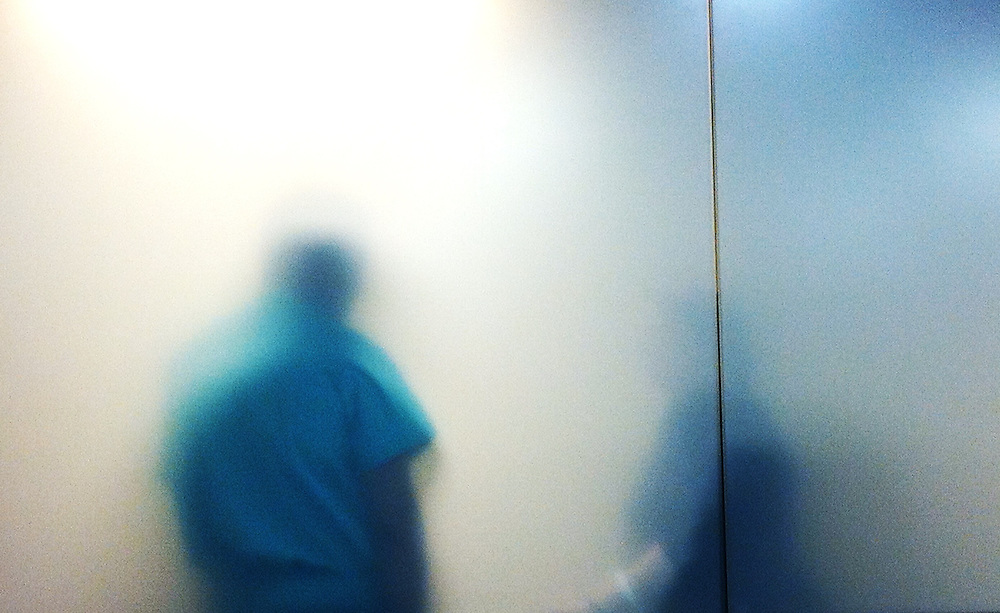 Silhouette of doctors in hospital waiting room