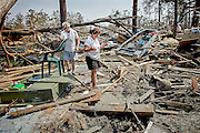 Devastation after the Katrina hurricane. In Bay St. Louis, two survivors look through the debris in search for their house and for any belongings that may have survived the hurricane and the storm surge.