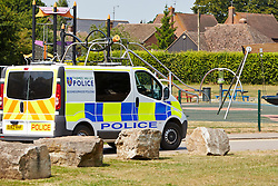"""© Licensed to London News Pictures.  18/07/2013. THAME, UK. A police van drives past a playground in Southern Road recreation ground in Thame, Oxfordshire where yesterday afternoon (Wed 17th) a 14-month old boy was hospitalised after picking up a discarded drugs wrap and chewing it. His condition is not thought to be serious but he was kept in overnight for observation.<br /> <br /> Police officers searched the scene for further paraphernalia and engaged with the council who will carry out additional cleaning at the recreation ground.<br /> <br /> Det Sgt Darren Cartwright of Thames Valley Police said: """"This was obviously a frightening experience for the boy's parents, but fortunately he doesn't seem to have been seriously harmed. It seems he had picked up a discarded paper wrap believed to have contained an illegal drug."""" <br /> <br /> Photo credit: Cliff Hide/LNP"""