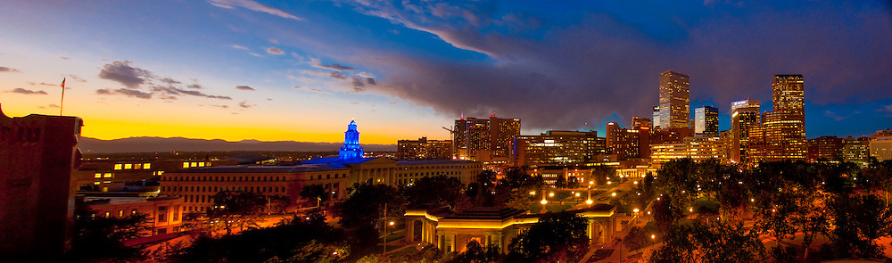 Panoramic view of downtown skyline with Denver Civic Center (City & County Bldg.) on left,  Denver, Colorado USA.