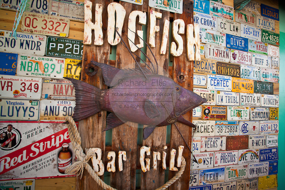 License plates decorate the wall at Hogfish Bar & Grill at Stock Island, Key West, Florida.