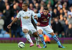 Swansea City's Wayne Routledge is tackled by Aston Villa's Ashley Westwood - Photo mandatory by-line: Harry Trump/JMP - Mobile: 07966 386802 - 21/03/15 - SPORT - FOOTBALL - Barclays Premier League - Aston Villa v Swansea City - Villa Park, Birmingham, England.