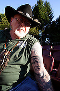 James Roberts of Elyria, Ohio shows off the Willie Nelson tattoo he's had for about three weeks at the Fraze Pavilion in Kettering, Thursday, August 11, 2011.  Roberts came down from the Cleveland area to see Nelson at the Fraze, and notes that his son Andy applied the tattoo.