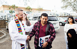January 30, 2018 - Tampa, Florida, U.S. - Reverend ANDY OLIVER, left, of Allendale United Methodist Church of St. Petersburg, Florida supports LUIS BLANCO of Plant City who works as a construction worker after talking with news reporters when arriving for his appointment at the United States Department of Homeland Security office. Blanco a father of six children and his wife Lauren who is pregnant with their seventh child was detained at the office after not having his humanitarian visa renewed under the President Donald Trump's administration. (Credit Image: © Octavio Jones/Tampa Bay Times via ZUMA Wire)