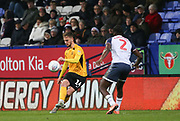 Southend United striker Brandon Goodship(14) and Bolton Wanderers Josh Emmanuel in action during the EFL Sky Bet League 1 match between Bolton Wanderers and Southend United at the University of  Bolton Stadium, Bolton, England on 21 December 2019.