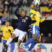 Ramires, Brazil, and Macnelly Torres, Colombia, (left) challenge during the Brazil V Colombia International friendly football match at MetLife Stadium, New Jersey. USA. 14th November 2012. Photo Tim Clayton