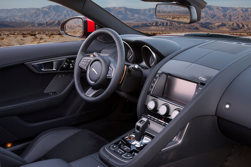 Black interior of a red 2014 Jaguar F-Type. photographed in the Desert of Palm Springs, CA