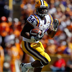 Oct 2, 2010; Baton Rouge, LA, USA; LSU Tigers running back Stevan Ridley (34) runs against the Tennessee Volunteers during the first half at Tiger Stadium.  Mandatory Credit: Derick E. Hingle