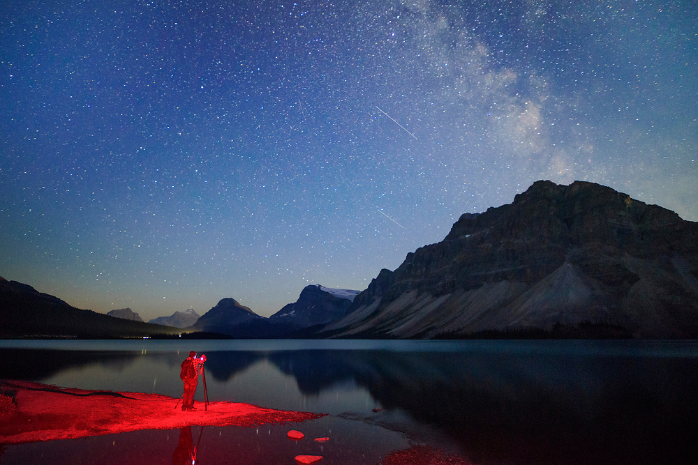 North America, Canada, Canadian,Alberta, Rocky Mountains, Banff National Park, UNESCO, World Heritage, Damion Shaw photographing at Bow lake with Milky way