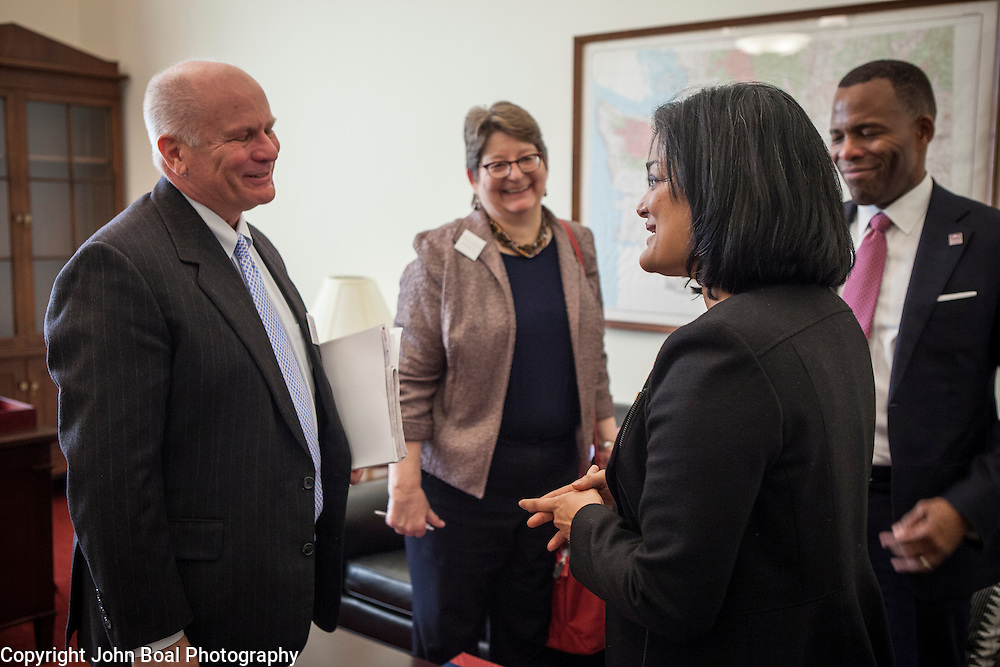 Representative Pramila Jayapal (D-WA, 7), finshes a meeting with the National Association of Independent Colleges and Universities, on Tuesday, January 31, 2017.  The meeting was one of four 30-minute meetings with constituent advocacy groups during the day.  John Boal photo/for The Stranger Representative Pramila Jayapal (D-WA, 7), finishes a meeting with Larry Probus, left, Violet Boyer and Isiaah Crawford, of the National Association of Independent Colleges and Universities, on Tuesday, January 31, 2017.  The meeting was one of four 30-minute meetings with constituent advocacy groups during the day.  John Boal photo/for The Stranger