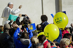 November 12, 2016 - Vatican City, Vatican - Pope Francis greets the faithful as he arrives to celebrate an extraordinary Jubilee Audience as part of ongoing celebrations of the Holy Year of Mercy in St. Peter's Square in Vatican City, Vatican on November 12, 2016. Pope Francis presided over the last special audience for the Jubilee of Mercy this morning, during which he called on Christians to witness to Gods mercy by being inclusive. (Credit Image: © Giuseppe Ciccia/NurPhoto via ZUMA Press)