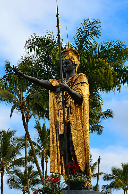 King Kamehameha Statue in Hilo, Island of Hawaii, Hawaii<br /> If you like this statue of King Kamehameha, who founded the kingdom of Hawaii, you have six chances to see it.  The original was cast by Thomas Gould in 1883 but was lost during a shipwreck so a replacement was made and erected in front of the Ali&rsquo;iōlani Hale in Honolulu.  The first statue was later recovered and stands in Kohala, David Kalākaua&rsquo;s birthplace.  This replica is near downtown Hilo. The 14 foot statue was created by R. Sandrin in 1963.  Other reproductions are at Hawaii&rsquo;s state capitol, a resort on Maui and in Las Vegas.