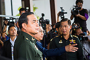 "20 MAY 2104 - BANGKOK, THAILAND:  General PRAYUTH CHAN-OCHA, Commander-in-Chief of the Royal Thai Army, arrives at the Army Club after the declaration of martial law. Gen. Prayuth called members of Thai society to the Army Club to tell them about martial law. The Thai Army declared martial law throughout Thailand in response to growing political tensions between anti-government protests led by Suthep Thaugsuban and pro-government protests led by the ""Red Shirts"" who support ousted Prime Minister Yingluck Shinawatra. Despite the declaration of martial law, daily life went on in Bangkok in a normal fashion. There were small isolated protests against martial law, which some Thais called a coup, but there was no violence.  PHOTO BY JACK KURTZ"