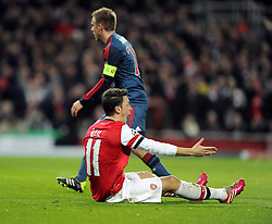 Arsenal's Mesut Ozil appeals for a penalty - Photo mandatory by-line: Joe Meredith/JMP - Tel: Mobile: 07966 386802 19/02/2014 - SPORT - FOOTBALL - London - Emirates Stadium - Arsenal v Bayern Munich - Champions League - Last 16 - First Leg