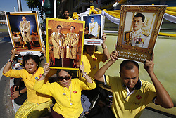 May 4, 2019 - Bangkok, Thailand - Well-wishers seen holding a portrait of Thailand's King Maha Vajiralongkorn Bodindradebayavarangkun (Rama X) as they waits near the Grand Palace for the royal coronation in Bangkok. (Credit Image: © Chaiwat Subprasom/SOPA Images via ZUMA Wire)