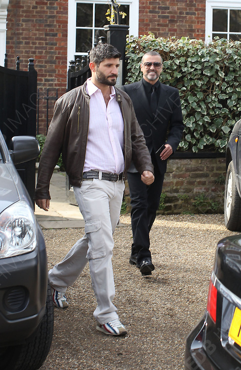 14.MARCH.2012. LONDON<br /> <br /> GEORGE MICHAEL LEAVING HIS HIGHGATE HOME WITH HIS BOYFRIEND FADI FAWAZ IN LONDON<br /> <br /> BYLINE: EDBIMAGEARCHIVE.COM<br /> <br /> *THIS IMAGE IS STRICTLY FOR UK NEWSPAPERS AND MAGAZINES ONLY*<br /> *FOR WORLD WIDE SALES AND WEB USE PLEASE CONTACT EDBIMAGEARCHIVE - 0208 954 5968*