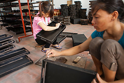 Women work in a workshop in Hanoi, Vietnam, Southeast Asia