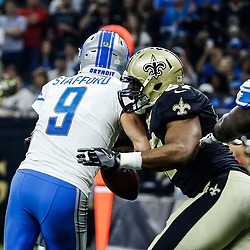 Oct 15, 2017; New Orleans, LA, USA; New Orleans Saints defensive end Alex Okafor (57) strips Detroit Lions quarterback Matthew Stafford (9) in the endzone strong safety Kenny Vaccaro (not pictured) recovered the ball for a touchdown during the first quarter of a game at the Mercedes-Benz Superdome. Mandatory Credit: Derick E. Hingle-USA TODAY Sports