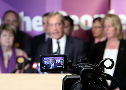 "© Licenced to London News Pictures. 26/05/2014. London. UK.  <br /> Nigel Farage, leader of the UK Independence Party (UKIP), is pictured in a television camera celebrating his European Parliamentary success in a press conference in London, May 26th 2014. The UKIP leader said his ""dream has become a reality"" and UKIP is now the ""third force"" in British politics after it topped the European polls.<br /> Photo Credit: Susannah Ireland"