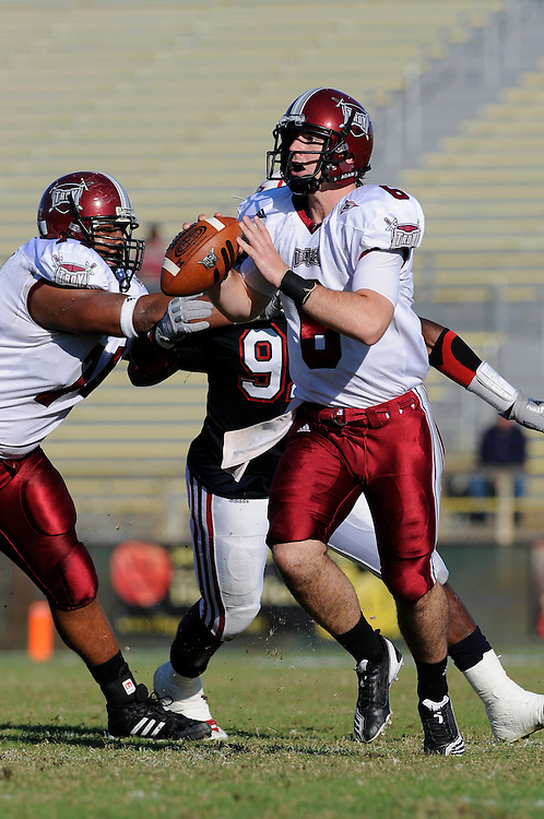December 4, 2010: Cory Robinson of the Troy Trojans scrambles as Nate Newland blocks Kevin Cyrille of the Florida Atlantic Owls during the NCAA football game between Troy and the FAU. The Trojans defeated the Owls 44-7.