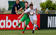 Canada defender Loic Cloutier (5) and Slovenia midfielder Enej Marsetic (9) fight for possession of the ball during a CONCACAF boys under-15 championship soccer game, Saturday, August 10, 2019, in Bradenton, Fla. Slovenia defeated Canada in 2-1 in overtime and advanced to the finals against Portugal. (Kim Hukari/Image of Sport)