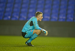 READING, ENGLAND - Wednesday, March 12, 2014: Reading's goalkeeper Lewis Ward looks dejected as Liverpool score the fourth goal in extra-time during the FA Youth Cup Quarter-Final match at the Madejski Stadium. (Pic by David Rawcliffe/Propaganda)