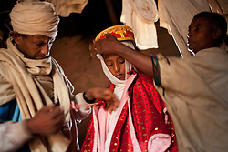 Destaye, 11, marries Addisu, 23, in a traditional Ethiopian Orthodox wedding ceremony  in the rural area outside Bahir Dar, Ethiopia on Feb. 4, 2008. Community members say that Destaye was married to Addisu at such a young age because, as a priest, it was necessary his bride be a virgin. According to the United Nations Population Fund, UNFPA, 37 percent of young women in sub-Saharan Africa aged 20 to 24 were married before turning 18. In 2010, there were 13.1 million girls married by age 18 in sub-Saharan Africa and the number is expected to rise to 15 million by 2030.
