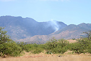 A lightening caused forest fire is monitored in the early stages by Coronado National Forest officials in Sawmill Canyon, Santa Rita Mountains northwest of Sonoita, Arizona, USA.