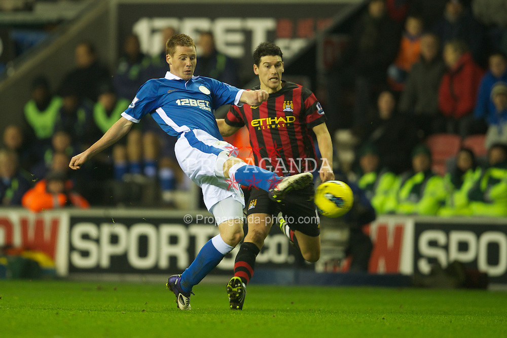 WIGAN, ENGLAND - Monday, January 16, 2011: Manchester City's Gareth Barry in action against Wigan Athletic's James McCarthy during the Premiership match at the DW Stadium. (Pic by David Rawcliffe/Propaganda)