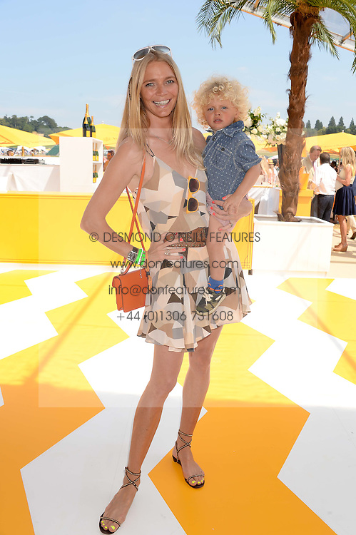 JODIE KIDD and her son Indio Vianini Kidd at the Veuve Clicquot Gold Cup, Cowdray Park, Midhurst, West Sussex on 21st July 2013.