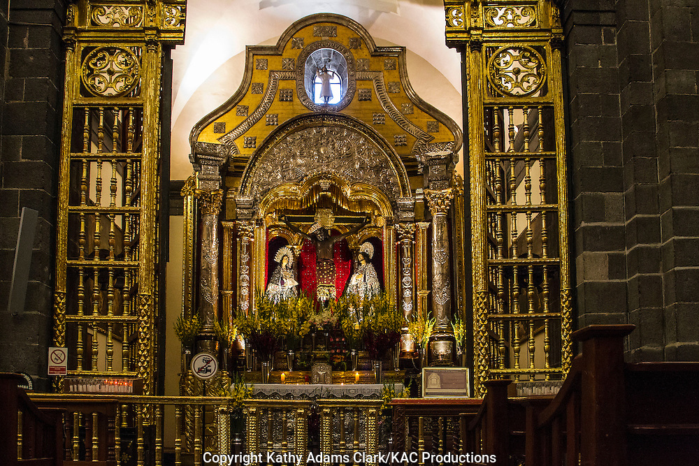 Gold and silver alter inside  of the cathedral in Cusco, Peru. El Senor de los Temblores is the Lord of the Earthquakes.  The crucifix is said to calm people during the 1650 earthquake.