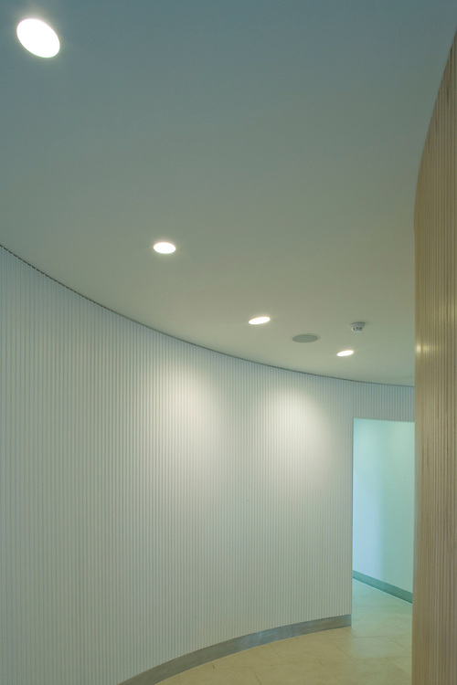 curved corridor with ceiling lights