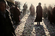 Monks standing in the smoke during Sojong (confession) festival at Kirti Monastery.  Since the March 16th riots, surveillance camera have been set up around the monastery, monks have to attend reeducation classes.