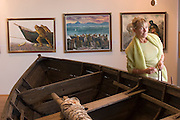 ICE.MWdrv05.10.xrw..Whaling exhibit at the Maritime Museum of Reykjavik, Iceland. Margret (Linda) Gunnlaugsdottir, 52, works part time here. Ten years ago she and her family were the Icelandic participants in Material World: A Global Family Portrait, 1994 for which they took all of their possessions out of their house for a family and possessions portrait in the snow. Pages 162-163. {{Central image from original book project is: ICE.mw.01.xxs.}}.