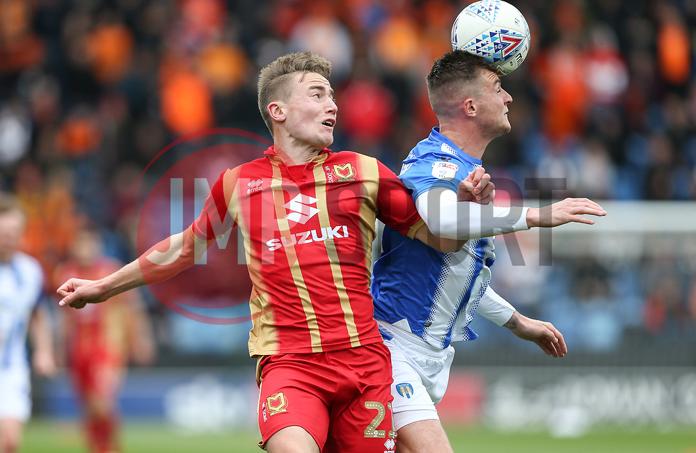 Ben Dickenson of Colchester United gets his head to the ball ahead of David Wheeler of Milton Keynes Dons - Mandatory by-line: Arron Gent/JMP - 27/04/2019 - FOOTBALL - JobServe Community Stadium - Colchester, England - Colchester United v Milton Keynes Dons - Sky Bet League Two