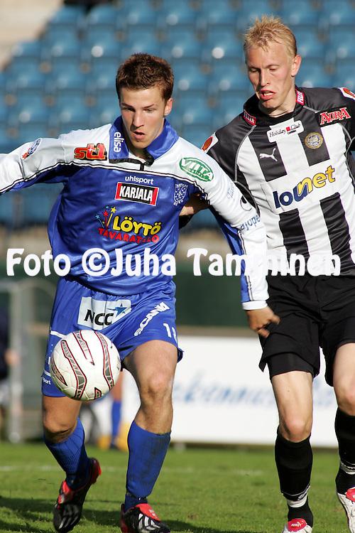 16.06.2004, Veritas Stadion, Turku, Finland..Suomen Cup. 5. kierros / Finnish Cup, 5th round.FC TPS Turku v Tampere United.Toni Junnila (TamU) v Ville Lehtonen (TPS).©Juha Tamminen.....ARK:k