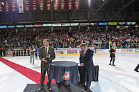 KELOWNA, CANADA - MAY 13: Richard Doerksen, VP of Hockey and WHL Commissioner Ron Robison stand on the ice for the official trophy presentation on May 13, 2015 during game 4 of the WHL final series at Prospera Place in Kelowna, British Columbia, Canada.  (Photo by Marissa Baecker/Shoot the Breeze)  *** Local Caption *** Richard Doerksen; Ron Robison;