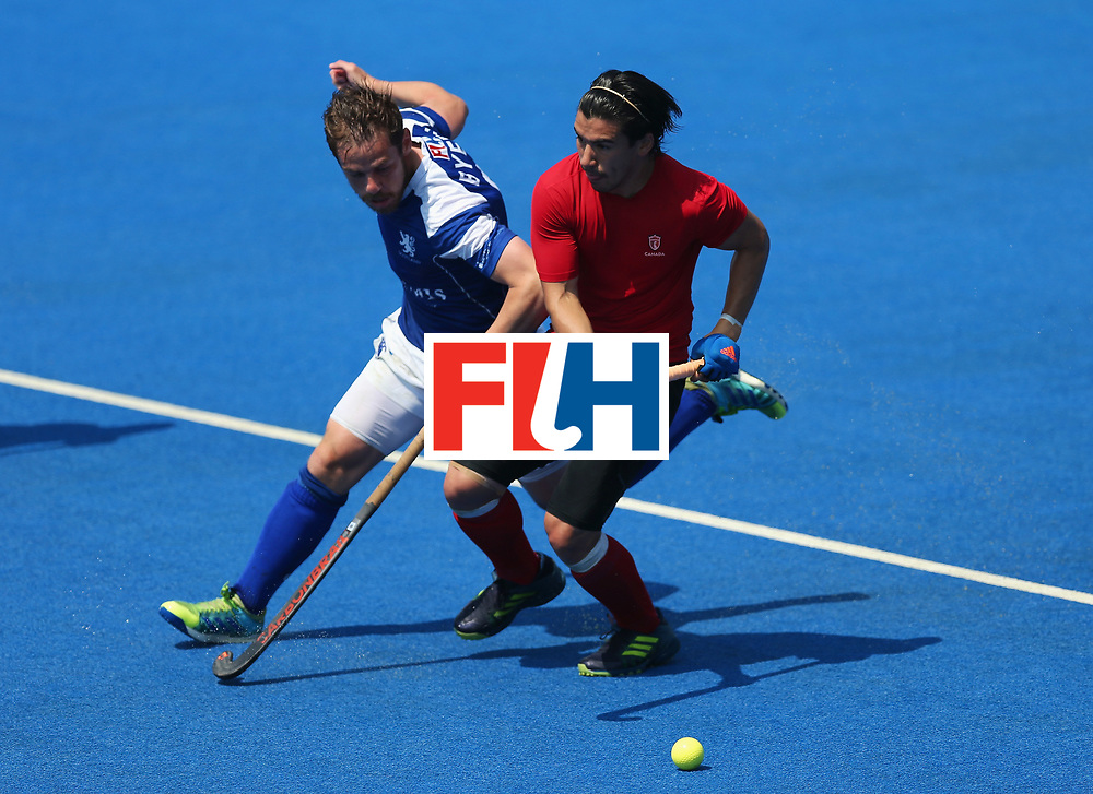 LONDON, ENGLAND - JUNE 20:  Gavin Byers of Scotland and Gabriel Ho-Garcia of Canada battle for the ball during the Pool B match between Scotland and Canada on day six of the Hero Hockey World League Semi-Final at Lee Valley Hockey and Tennis Centre on June 20, 2017 in London, England.  (Photo by Alex Morton/Getty Images)