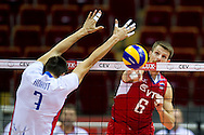 (R) Evgeny Sivozhelev from Russia in action during the 2013 CEV VELUX Volleyball European Championship match between Russia v Slovakia at Ergo Arena in Gdansk on September 24, 2013.<br /> <br /> Poland, Gdansk, September 24, 2013<br /> <br /> Picture also available in RAW (NEF) or TIFF format on special request.<br /> <br /> For editorial use only. Any commercial or promotional use requires permission.<br /> <br /> Mandatory credit:<br /> Photo by © Adam Nurkiewicz / Mediasport