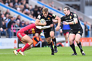 Lachie Turner of Exeter Chiefs is tackled during the Aviva Premiership match between Exeter Chiefs and Harlequins at Sandy Park, Exeter, United Kingdom on 19 November 2017. Photo by Graham Hunt.