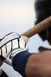 12 August 2011:  batters gloves and bat during a game between the Rockford River Hawks and the Normal Cornbelters at the Corn Crib in Normal Illinois.