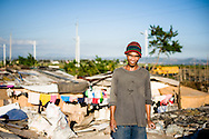 Philippines, Metro Manila. Jojo, a scravenger from Taguig in front of his house at the dump site.